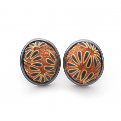 Button Earring (176), 2016, polymer & sterling, 1x 1 1/4 x 1/2″, $250.