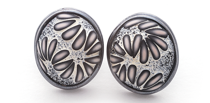 Button Earring (177), 2016, polymer & sterling, 1x 1 1/4 x 1/2″, $250.