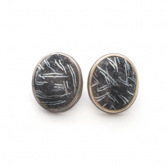 Button Earring (194), 2016, polymer & sterling, 1x 1 1/4 x 1/2″, $250.